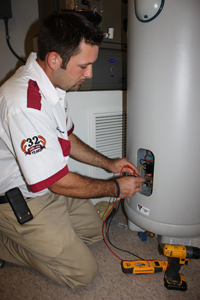 technician-performing-water-heater-maintenance